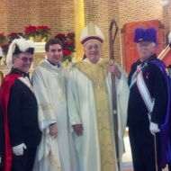 On December 30, members of St. Matthew Norwalk Knights of Columbus Council 14360, representing Assembly #100, Bishop Fenwick in Norwalk, attended Mass at Our Lady of Solace church in the Coney Island section of Brooklyn. The assembly members dressed in full color guard regalia and were led by Color Corps Commander Bill Berger, Faithful Navigator of Assembly #100. The Mass was celebrated by the Bishop of Brooklyn, Bishop Nicholas DeMarzio. Our Lady of Solace Parish was hit hard by Hurricane Sandy, and through St. Matthew' Parish in Norwalk, the Knights have helped out with goods, Christmas gifts and other supplies to get parishioners through the holidays. In the picture with Bishop DeMarzio are Sir Knights Anthony Armentano, Scott Mazzo, Mike Colaluca, Bill Berger, George Ribellino and Scott Criscuolo.