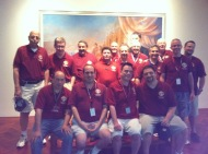 Members of Council 14360 pose in front of a portrait of Fr. Michael McGivney, founder of the Knights.